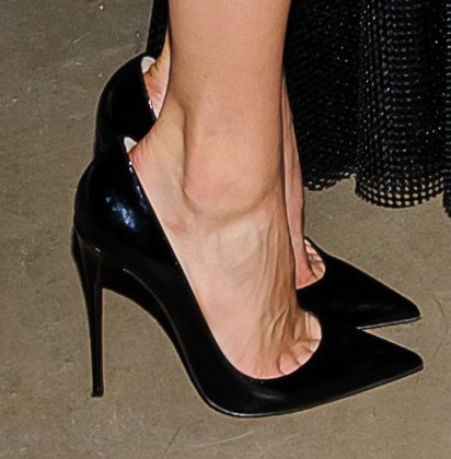 Emmy Rossum wearing patent leather 'So Kate' pumps