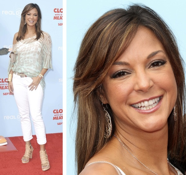 Eva LaRue looking youthful in white jeans and a sheer off-shoulder top paired with beige cage sandals at the premiere of 'Cloudy with a Chance of Meatballs 2'