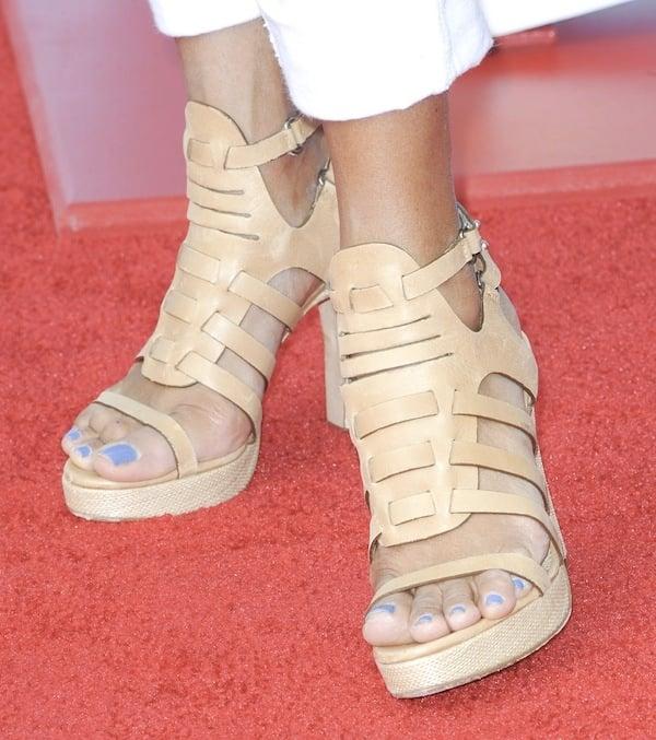 Eva LaRue showing off her feet inbeige cage sandals