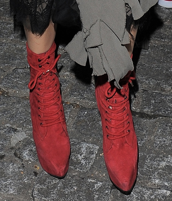 Georgia May Jagger wearing red pointy-toe boots