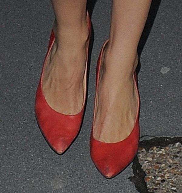 Georgia May Jagger wearing a striking pair of red pumps