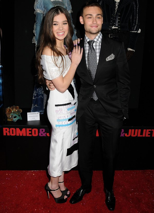 "Hailee Steinfeld, in a Prabal Gurung dress and Brian Atwood ""Tribeca"" platform sandals, cozying up to co-star Douglas Booth at the 'Romeo and Juliet' film premiere in Los Angeles, California, on September 24, 2013"