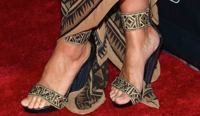Heidi shows off her feet in tribal shoes