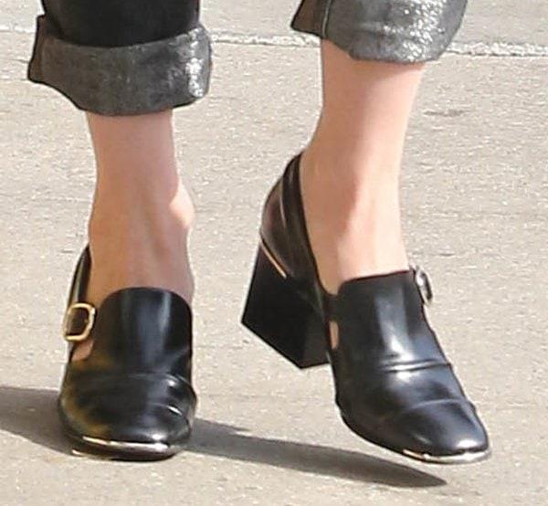 January Jones wearingblack leather Balenciaga loafers