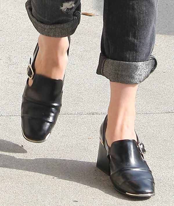 January Jones wearingblack leather Balenciaga Cube loafers