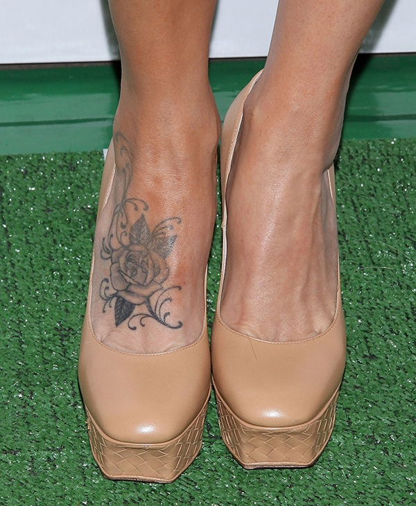 Jenny McCarthy's foot tattoo featuringan intricate rose with vines
