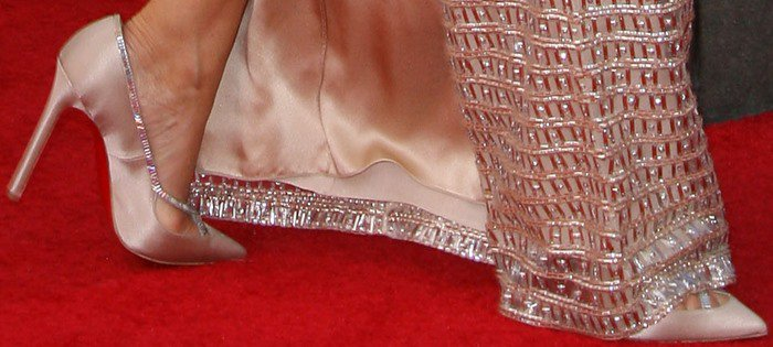 Julia Louis-Dreyfus finishes her look with a pair of crystal-trimmed satin pumps from Christian Louboutin