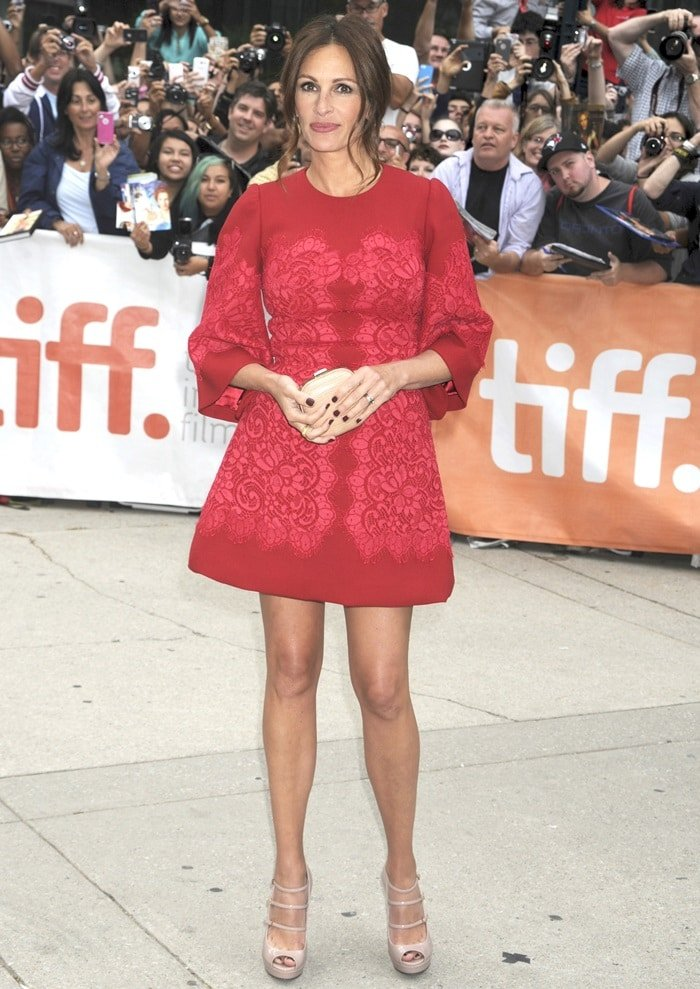 Julia Roberts in a red Dolce & Gabbana dress at the 'August: Osage County' premiere during the 2013 Toronto International Film Festival held at Roy Thomson Hall in Toronto, Canada, on September 9, 2013