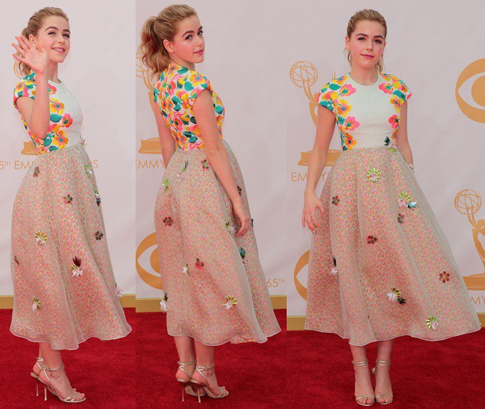 Kiernan Shipka waves and shows off her Delpozo Spring 2014 gown on the red carpet