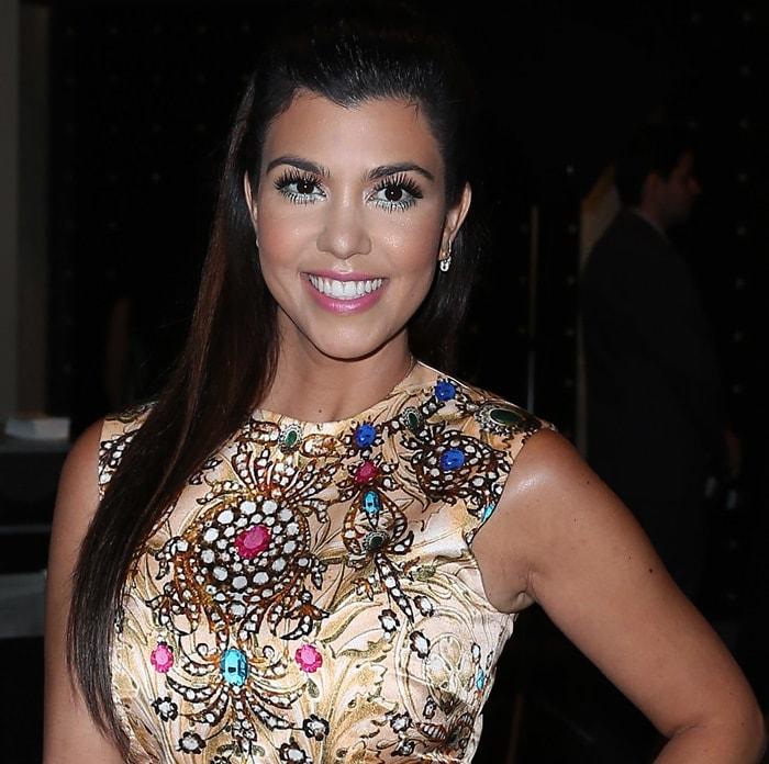 Kourtney Kardashian's glamorous gold mini dress by ASOS was intricately detailed with colorful gems