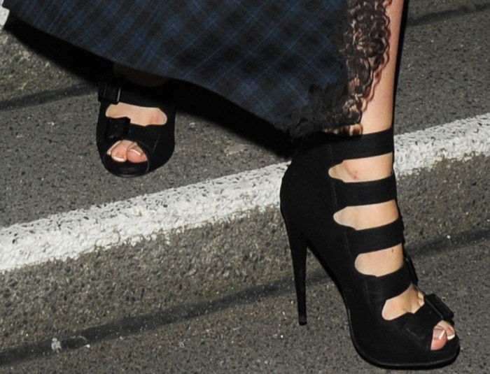 Laura Whitmore shows off a French pedicure in an edgy pair of buckled heels