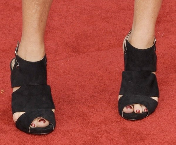 Marcia Gay Harden wearingblack cage sandals
