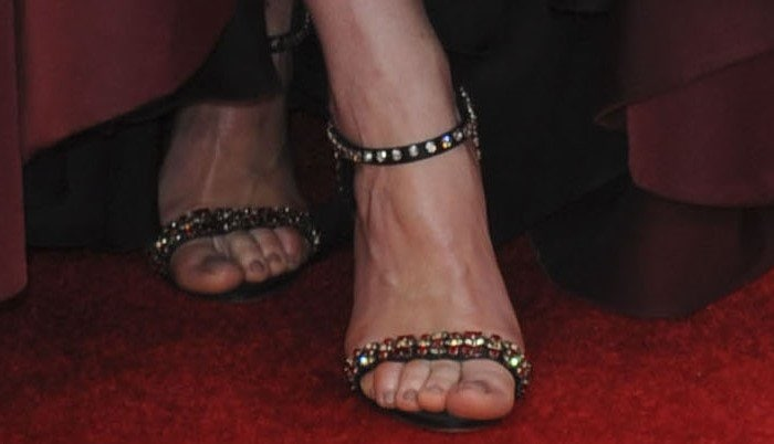 Michelle Dockery wears a pair of embellished Prada sandals on her feet