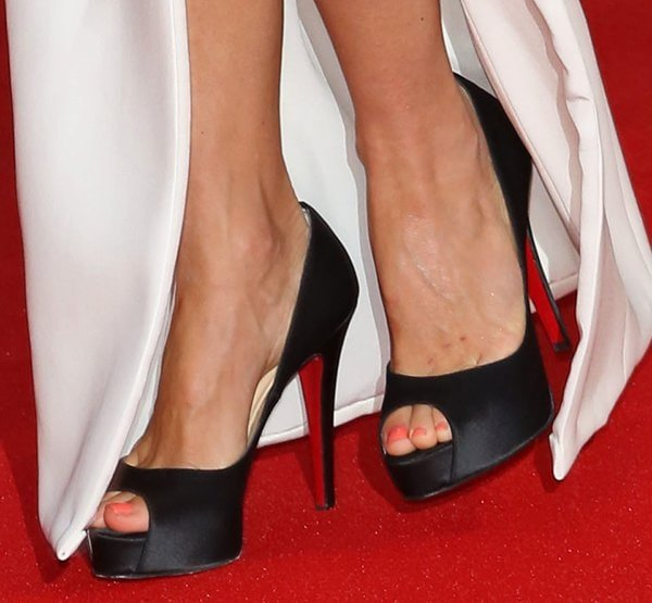 Naomi Watts completed the ensemble with a pair of black satin Christian Louboutin pumps featuring peep toes and 4.7 inch heels