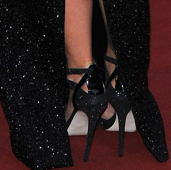 Rita Ora wearing black sandals by Burak Uyan