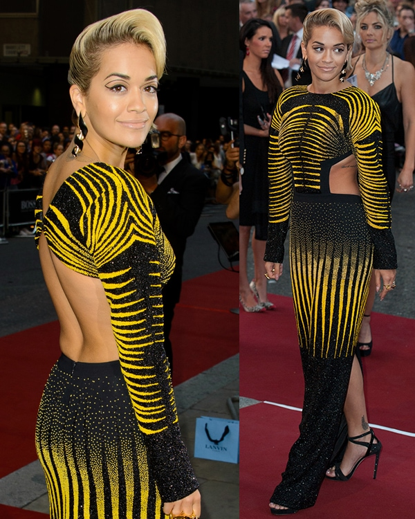 Rita Ora arrived in a stunning Etro Fall 2013 yellow-and-black microbeaded gown featuring cutout sides and back