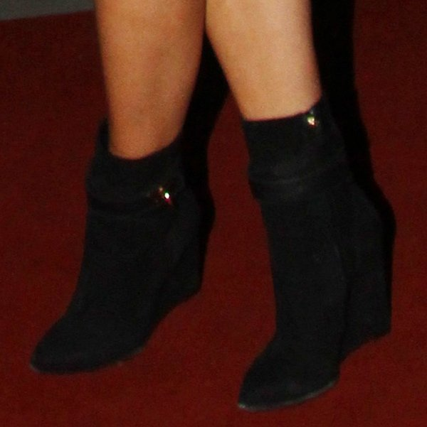 Rita Ora wearing black ankle wedge booties by Givenchy