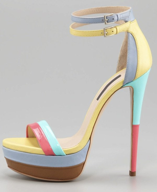 This Ruthie Davis sandal features a sprightly color story, a strappy silhouette, and a sky-high heel