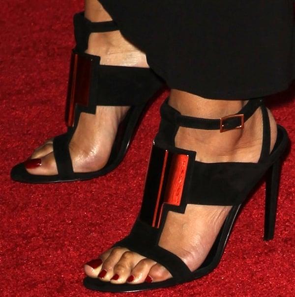 Keri Hilson shows off her hammer toes in black t-strap Saint Laurent sandals