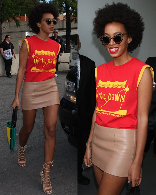 Solange Knowles in a yellow-and-red muscle tee with a beige leather skirt