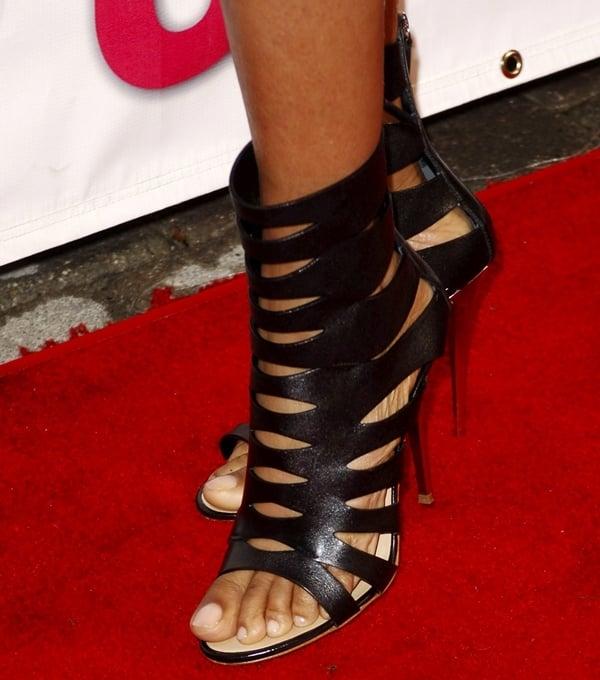Taraji P. Henson's pretty feet inblack Giuseppe Zanotti cut-out booties