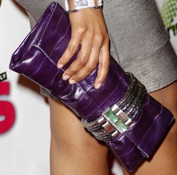 Taraji P. Henson carries a hot purple clutch