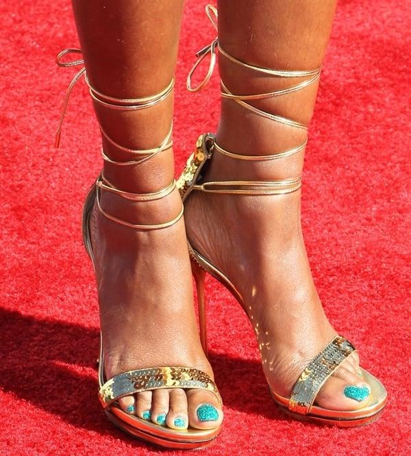 Taraji P. Henson shows off her hot pedicure in strappy stiletto sandals