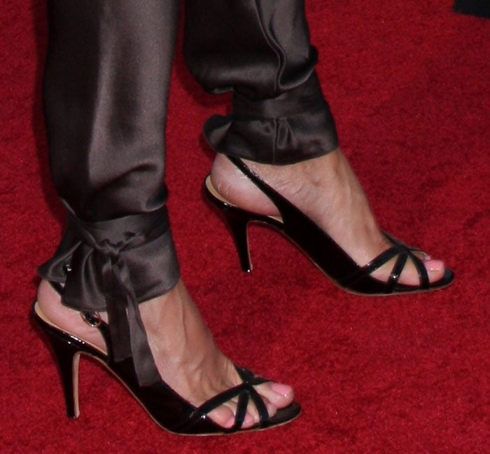 Tricia Helfer's feet in strappy sandals