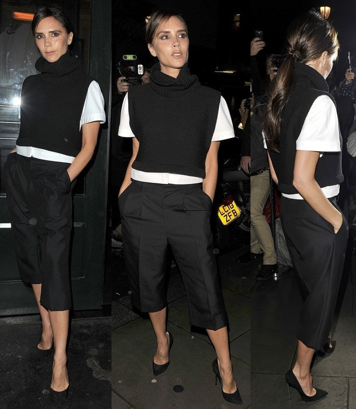 Victoria Beckham wearing a masculine outfit from her own fashion collection