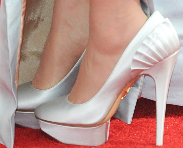 Zooey Deschanel wears a pair of icy-colored platform pumps from Charlotte Olympia