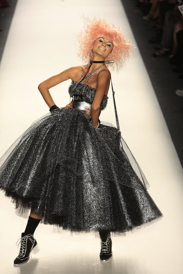 Model flouncing down the catwalk and showing off Betsey Johnson's latest creations