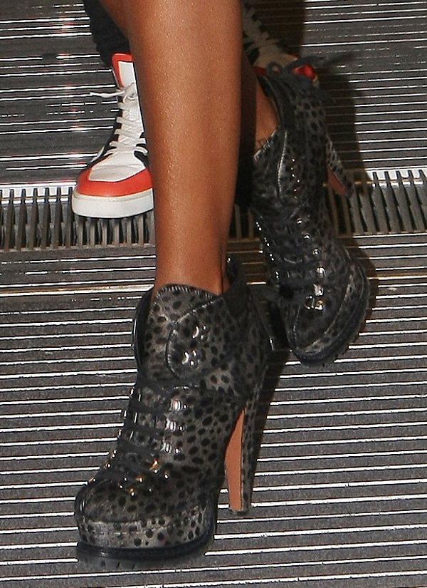 Brandy wears high-heeled animal print booties