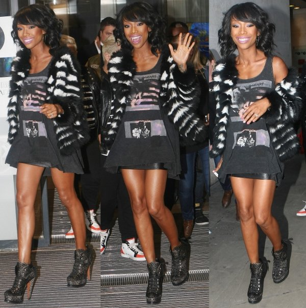 Brandy Norwood leaving BBC Radio1 in high heeled boots