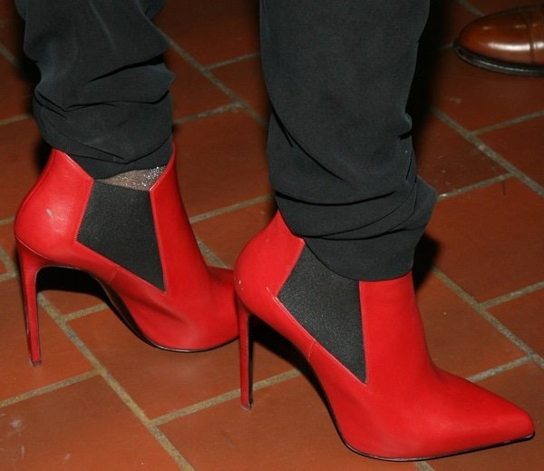 Catherine Malandrino wearing a pair of red booties for her spring 2014 presentation during 2014 Mercedes-Benz Fashion Week in New York City on September 10, 2013