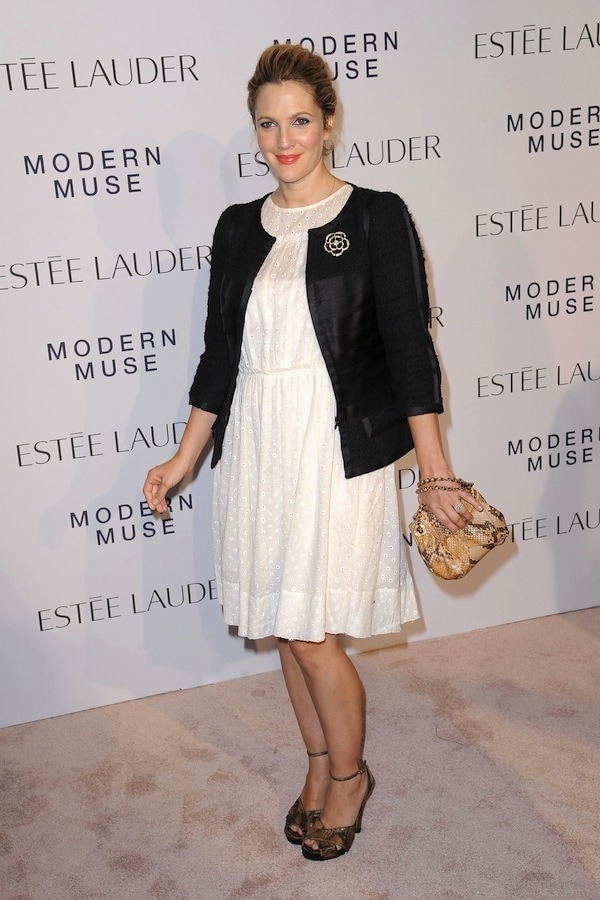 Drew Barrymore flashed her legs in an adorable white dress