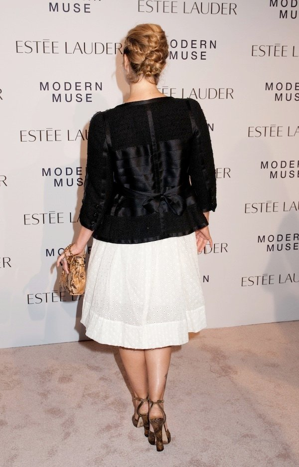 Drew Barrymore styled her white dress with a vintage black jacket from Chanel