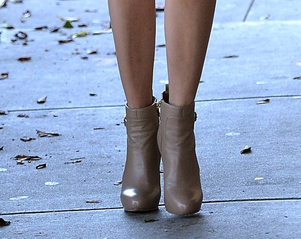 Emmy Rossum flaunts her legs in fawn-colored ankle boots