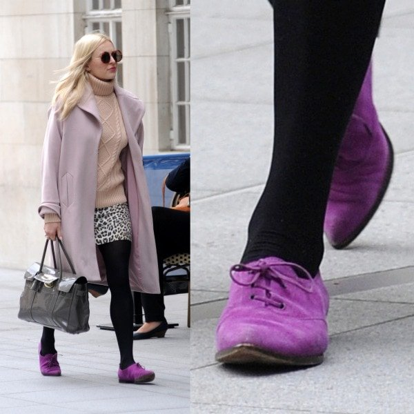 Fearne Cotton arriving at the BBC Radio 1 studios in a Marks & Spencer coat, a Stefanel sweater, a leopard-print skirt, and purple lace-up shoes in London, United Kingdom, on September 19, 2013