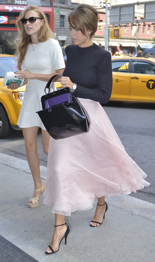 Jessica Alba and a friend returning to their hotel after attending a Ralph Lauren fashion show in New York City on September 12, 2013