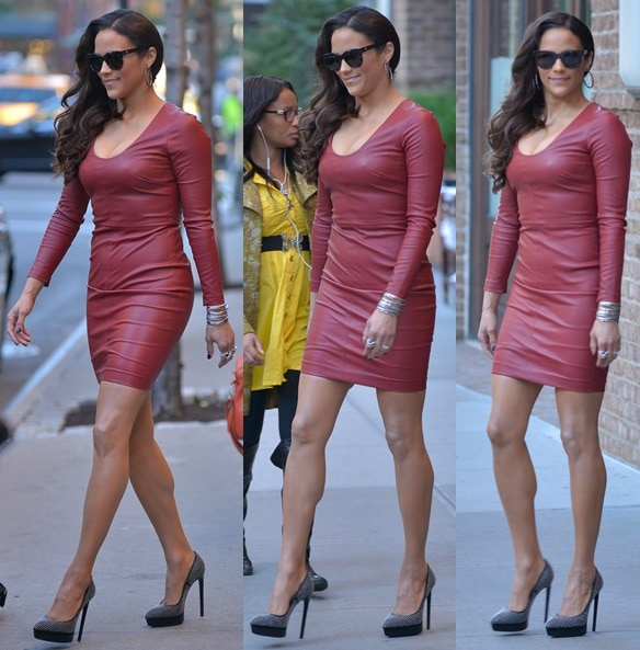 Paula Patton in a red leather dress and studded black pumps