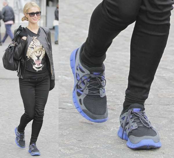 Paris Hilton wears blue and grey Nike running shoes
