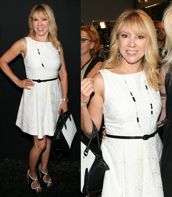 Ramona Singer slipping into unique perforated sandals for the Zang Toi spring 2014 presentation during 2014 Mercedes-Benz Fashion Week in New York City on September 10, 2013