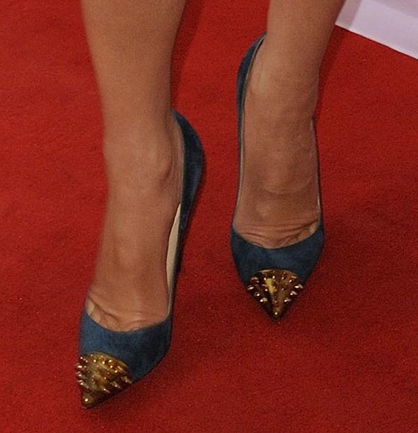 Sandra Bullock wearing a green suede version of Christian Louboutin's 'Geo' heels