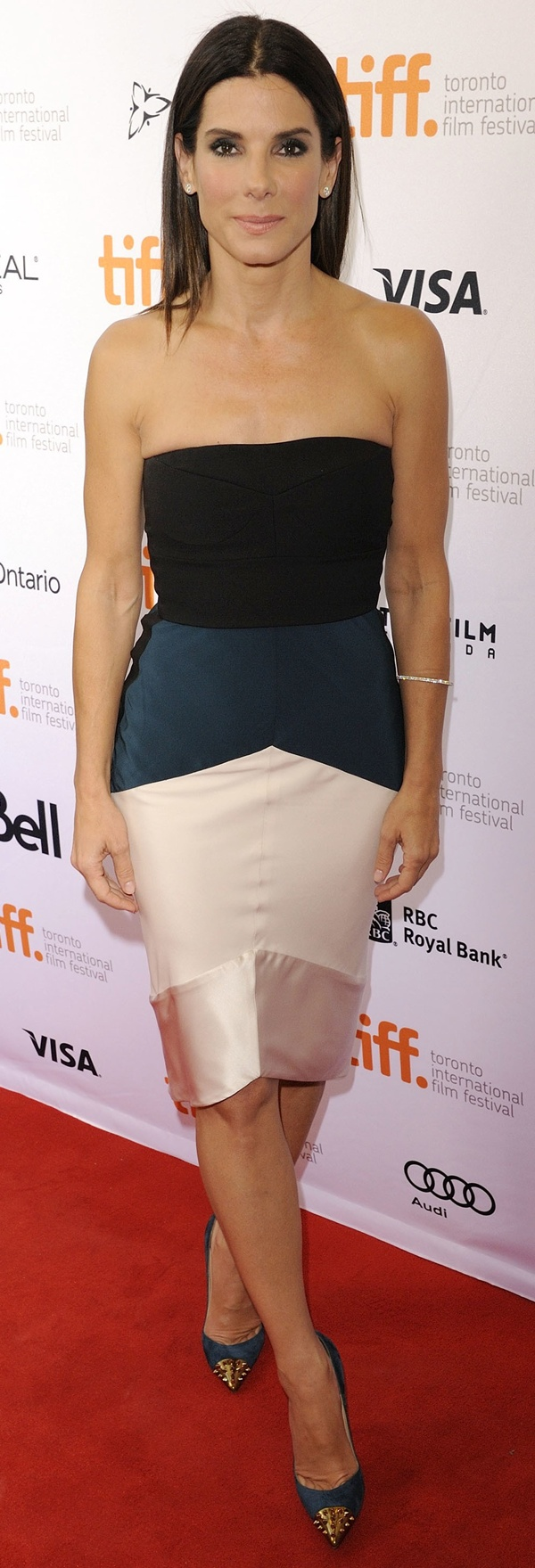 Sandra Bullock in a Narciso Rodriguez color-blocked dress with a bustier-inspired bodice and satin trim
