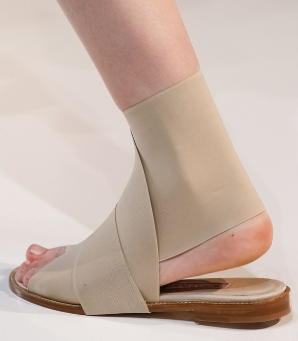 The always sleek and minimal Victoria Beckham sticking to her style aesthetic withpointymules and clean fuss-free bandage sandals for Spring 2014