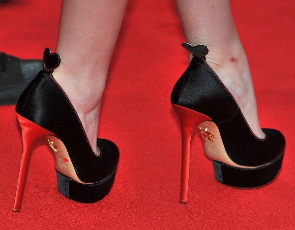 Anna Kendrick wearing Charlotte Olympia pumps with heart tab on the back