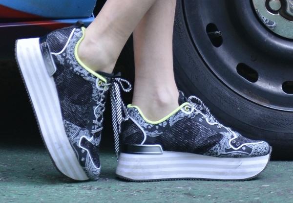 Cara Delevingne wearing platform sneakers