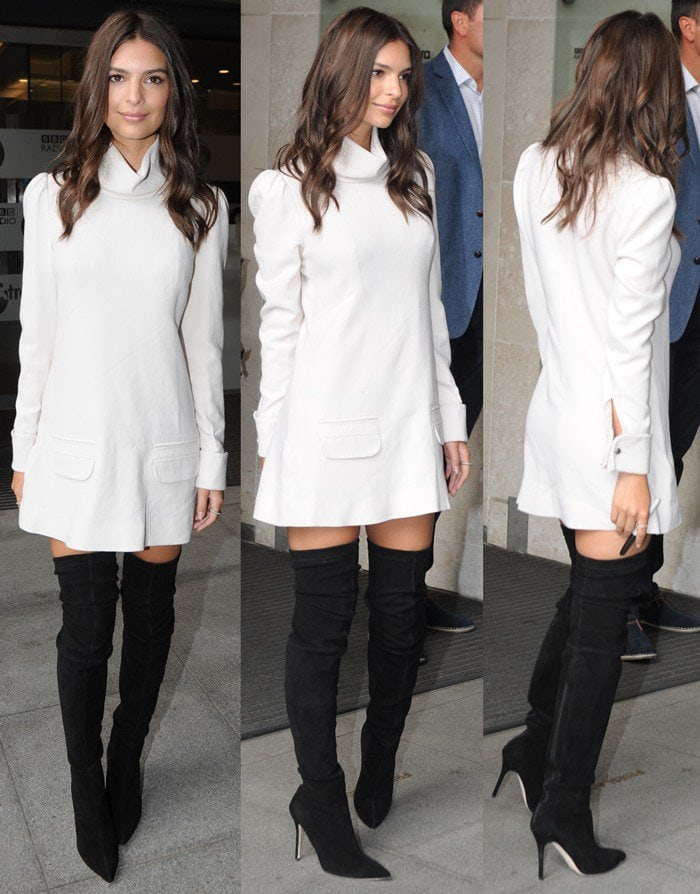 "Emily Ratajkowski wears a Zimmermann ""Esplanade"" crepe body dress and Brian Atwood ""Odille"" suede thigh-high boots"