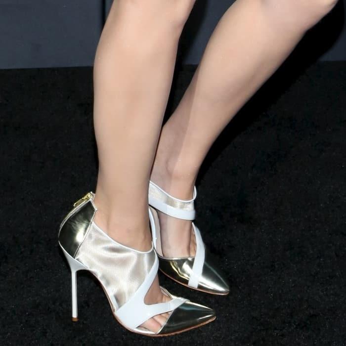 Emma Watson in J. Mendel two-tone metallic cut-out pumps