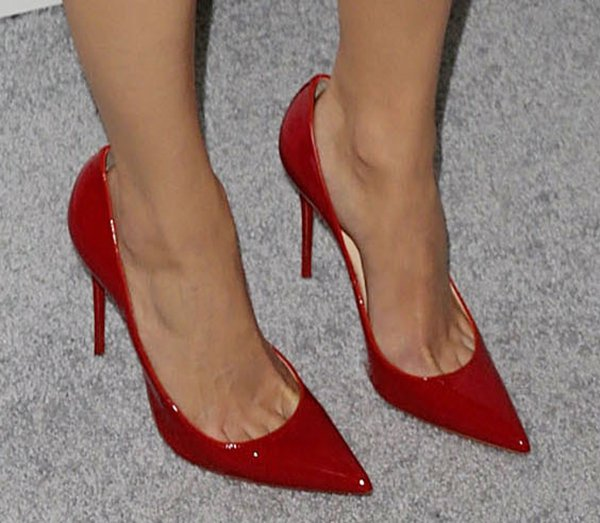 Emmy Rossum in a striking pair of red Christian Louboutin Fall 2012 heels